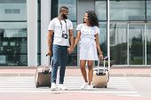 Happy African Newlyweds Enjoying Honeymoon Trip, Arrived To Airport With Luggage poster