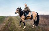Warrior Viking Blonde Female Riding A Horse - Medieval Movie Scene poster