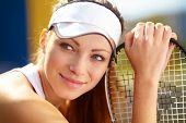 Portrait of a young female tennis player