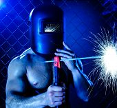 stock photo of welding  - the beauty muscular worker welder man weld electric arc - JPG