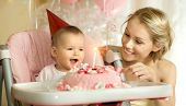 stock photo of solemn  - one-year-old little girl with mammy solemnize birthday happy laughter horizontal photo