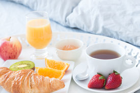 picture of pillowcase  - Close-up of tray with tasty breakfast on a bed. ** Note: Shallow depth of field - JPG