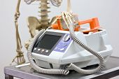 stock photo of defibrillator  - Medical still life with defibrillator and skeleton