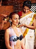 foto of panchakarma  - Woman having Ayurvedic spa treatment - JPG