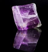 pic of peridot  - Fluorite Crystal Purple with reflection on black surface background  - JPG
