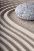 Japanese meditation spa garden pattern of sand and stones with curved lines for balance and relaxati