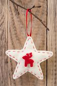 Star decoration hanging against wooden background