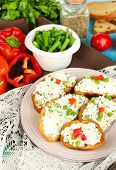 foto of hardtack  - Sandwiches with cottage cheese and greens on plate on wooden table close - JPG