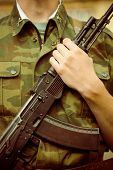 foto of ak 47  - Closeup shot of soldier with AK-47 assault rifle