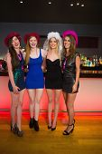 stock photo of hen party  - Laughing friends having a hen party at the bar and looking at camera - JPG