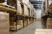 picture of pallet  - industrial warehouse interior with shelves and pallets with cartons - JPG
