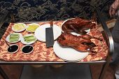 pic of chinese restaurant  - Table with peking duck in a chinese restaurant - JPG