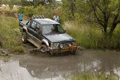 Viridian Green Mitsubishi Colt Rodeo Twin Cab Crossing Muddy Pond