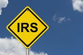 pic of precaution  - IRS Warning Sign An American road warning sign with word IRS with a sky background - JPG