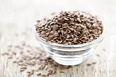 stock photo of flaxseeds  - Bowl full of brown flax seed or linseed - JPG