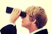 Business Vision concept - young man with binoculars
