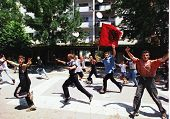 MITROVICA, KOSOVO - JULY 2: Angry Kosovar Albanians run through the streets on their way to a French