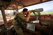MARJAYOUN - MARCH 22 An Israeli defense force (IDF) soldier looks out over southern Lebanon from an