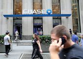 NEW YORK CITY - JULY 11: Pedestrians walk past a branch office of  Chase Bank in lower Manhattan on