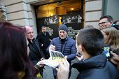 NEW YORK CITY - DECEMBER 28, 2013: Actor Daniel Craig greets fans outside of a Broadway theater wher