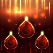 image of diya  - Vector glowing diwali diya on a background - JPG