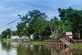 picture of fishnet  - Old Fishnet in Thai style house next to river - JPG