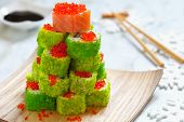 image of avocado tree  - Maki Sushi Roll Christmas Tree on a table - JPG