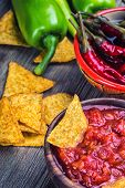 pic of doritos  - Salsa with tortilla chips and chilli peppers - JPG