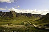 picture of pipeline  - A pristine view of the Alaska oil pipeline with valley and mountain views - JPG