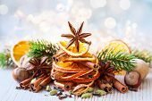 stock photo of walnut-tree  - Christmas tree made out of dried oranges - JPG