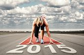 picture of sprinter  - Female sprinter waiting for the start on an airport runway - JPG
