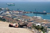 stock photo of gibraltar  - Strait of Gibraltar and middle aged woman tourist resting on the Rock of Gibraltar.