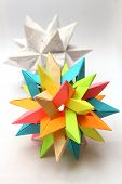 picture of tetrahedron  - Colorful modular origami paper star with white star in the background - JPG