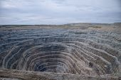 foto of open-pit mine  - Aerial View To The Diamond Open Mine In Udachny Town - JPG