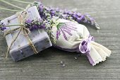 pic of sachets  - lavender soap and scented sachets with fresh flowers over wooden background - JPG