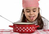 stock photo of ladle  - girl pretending to cook in a pot with ladle - JPG