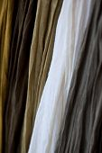 stock photo of chokers  - Scarves on a stall in a fashion store  - JPG