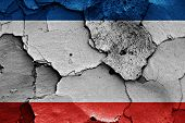 image of civil war flags  - flag of Crimea painted on cracked wall - JPG