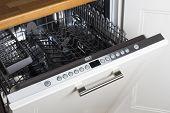 image of dishwasher  - modern Half open empty dishwasher in a modern kitchen - JPG