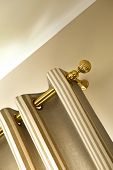 picture of rod  - Curtain and brass rod in a house - JPG