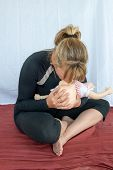 stock photo of cpr  - A Woman practising CPR on an infant Mannequin - JPG
