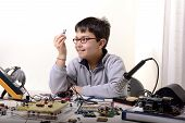 foto of experiments  - Young student performs experiments in electronics and dreams of the future - JPG