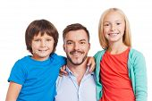 image of father child  - Happy father carrying two cheerful children and smiling while standing against white background - JPG