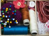 stock photo of handicrafts  - thread and material for handicrafts in box - JPG