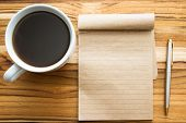 image of multi purpose  - fresh cup of coffee and a blank recycled note pad on a wooden background - JPG