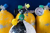 image of air pressure gauge  - Checking how much air is in a scuba Tank - JPG