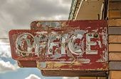 foto of motel  - Old weathered broken neon sign for a motel office in nature daytime - JPG