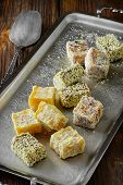 Turkish delight or rahat lokum on metal plate. Selective focus poster