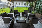 foto of grass area  - Wicker chairs on hotel - JPG