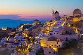 foto of windmills  - Sunset in Oia, Santorini island, Greece, view to Oia windmills during sunset ** Note: Visible grain at 100%, best at smaller sizes - JPG